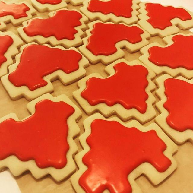 Shortbread cookies cut into 8-bit heart shapes and decorated with bright red royal icing.
